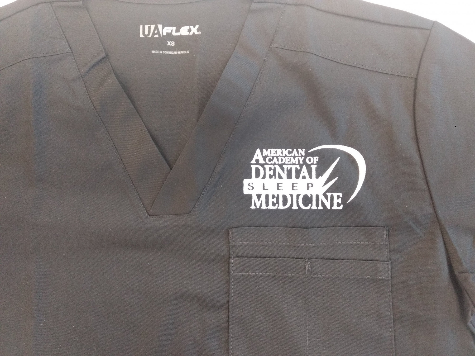 Close up of AADSM logo on scrub top