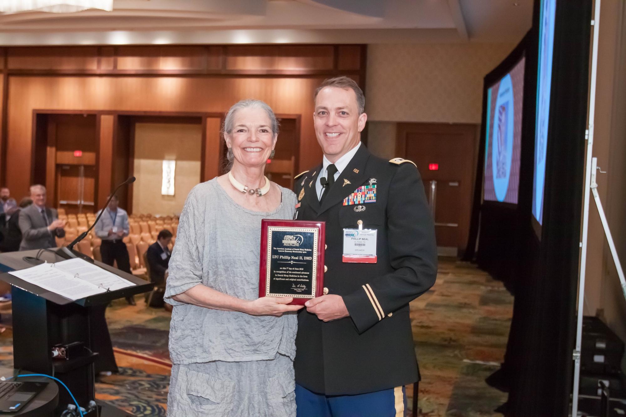 Participant winning AADSM Dental Research Award